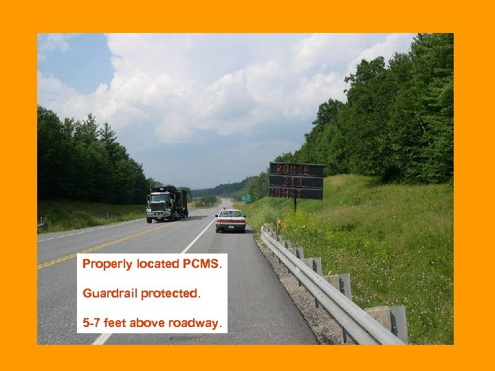 Properly located PCMS. Guardrail protected. 5 -7 feet above roadway.