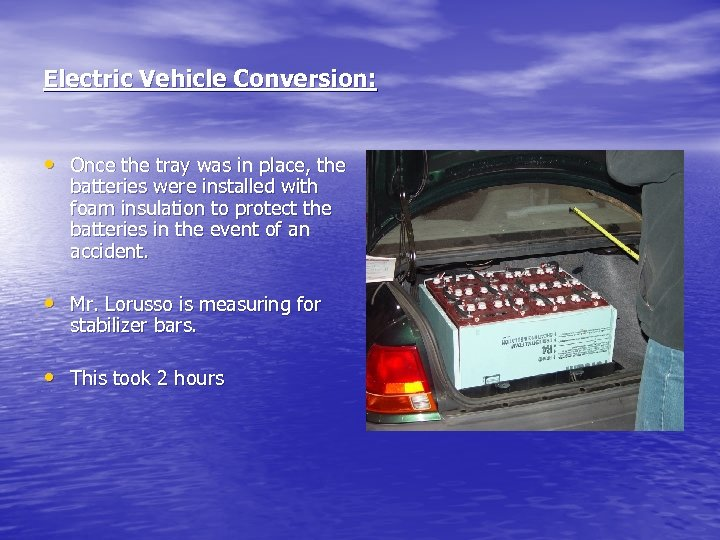 Electric Vehicle Conversion: • Once the tray was in place, the batteries were installed