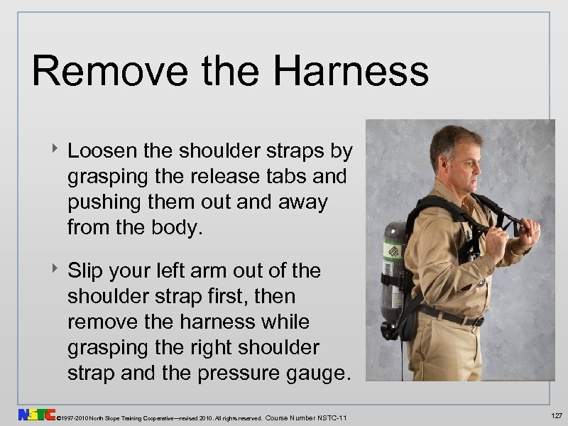Remove the Harness ‣ Loosen the shoulder straps by grasping the release tabs and