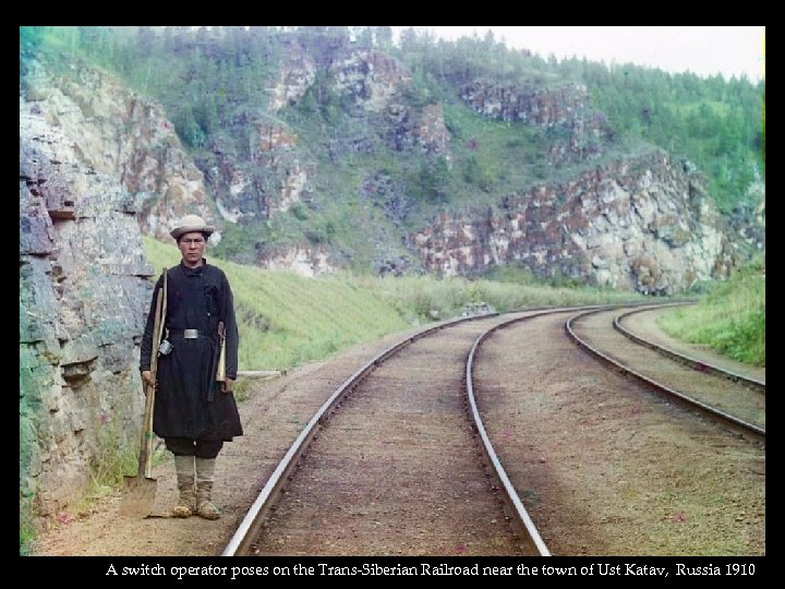 A switch operator poses on the Trans-Siberian Railroad near the town of Ust Katav,