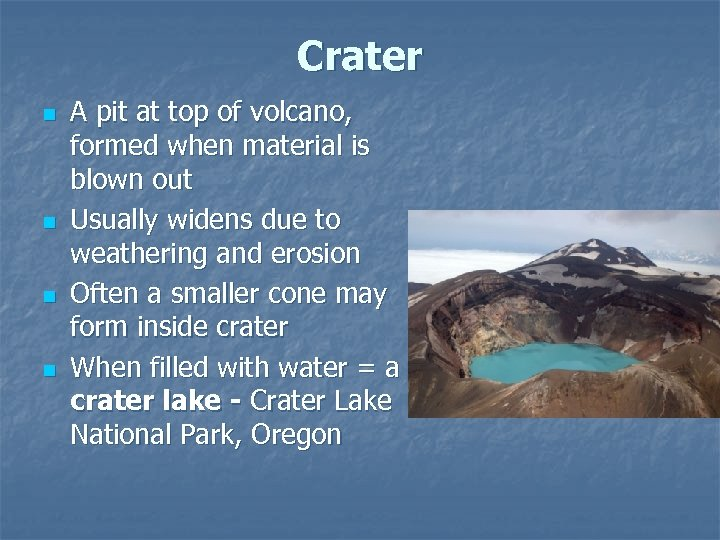Crater n n A pit at top of volcano, formed when material is blown
