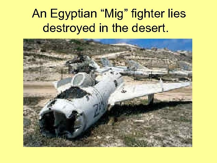 """An Egyptian """"Mig"""" fighter lies destroyed in the desert."""