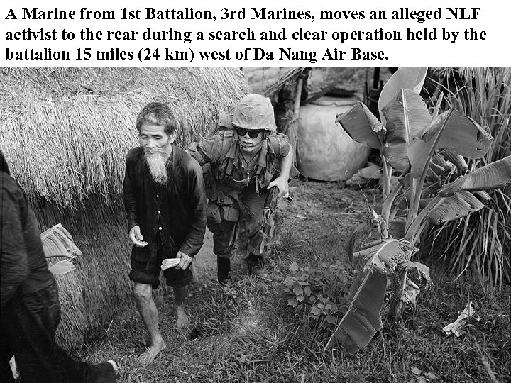 A Marine from 1 st Battalion, 3 rd Marines, moves an alleged NLF activist