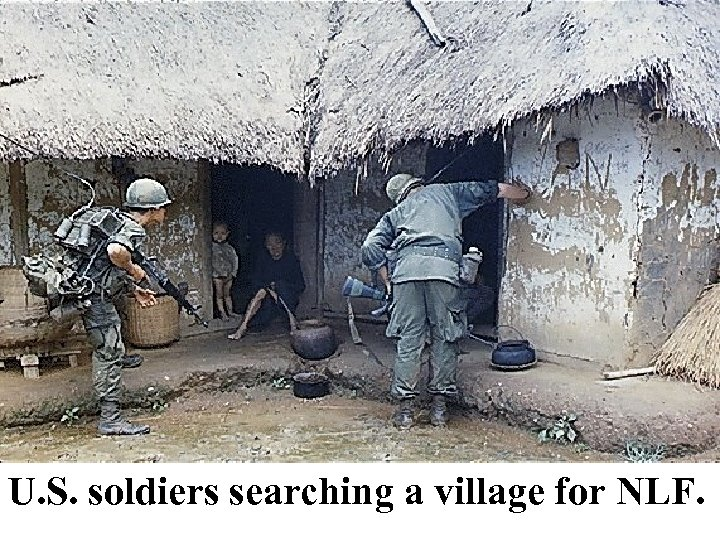 U. S. soldiers searching a village for NLF.