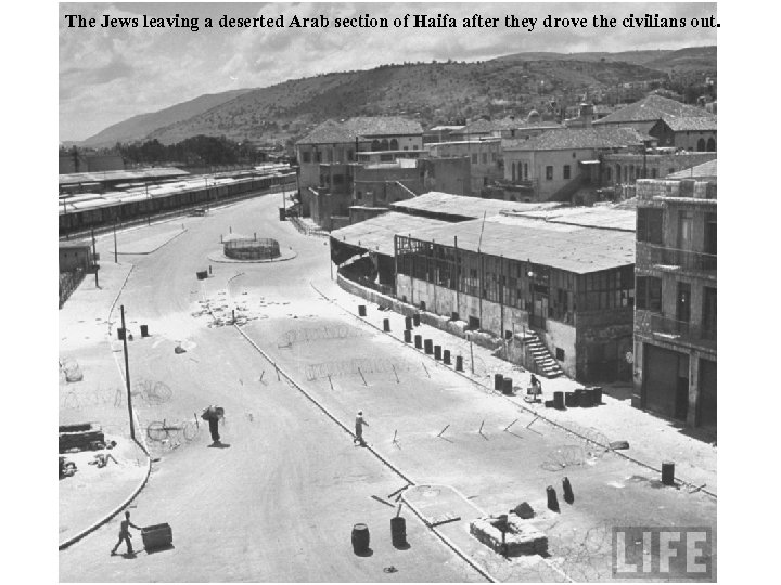 The Jews leaving a deserted Arab section of Haifa after they drove the civilians