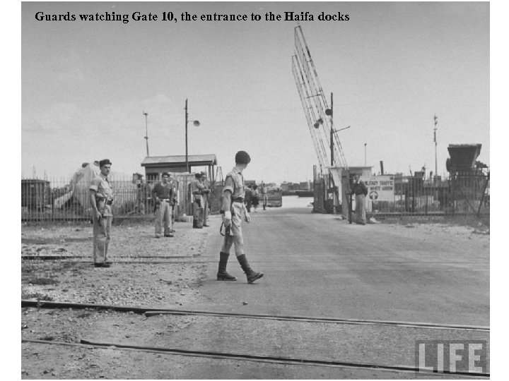 Guards watching Gate 10, the entrance to the Haifa docks