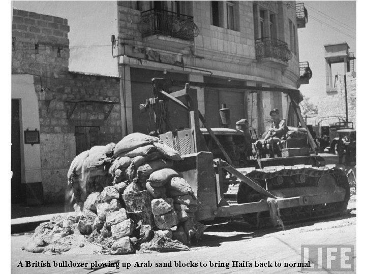 A British bulldozer plowing up Arab sand blocks to bring Haifa back to normal