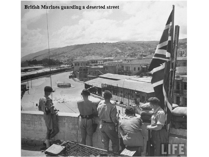 British Marines guarding a deserted street