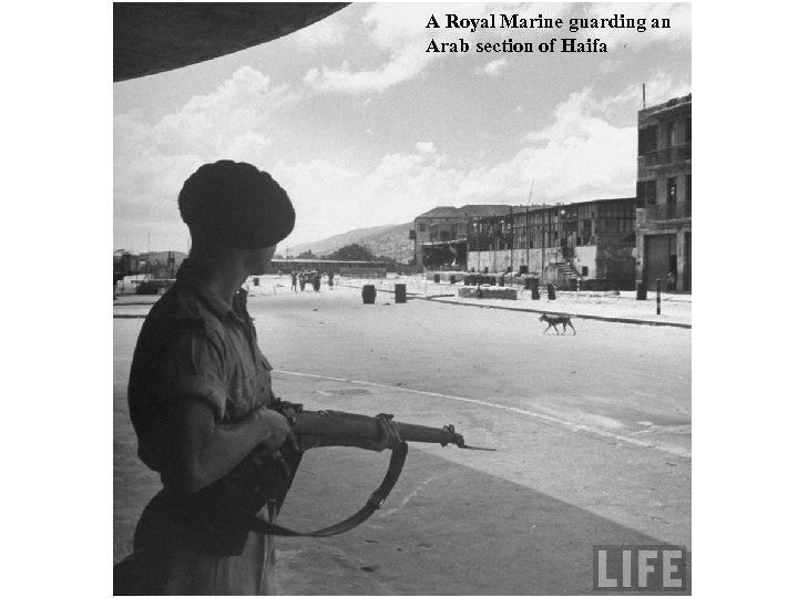 A Royal Marine guarding an Arab section of Haifa