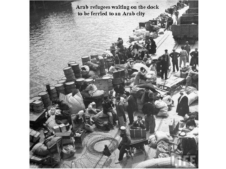 Arab refugees waiting on the dock to be ferried to an Arab city