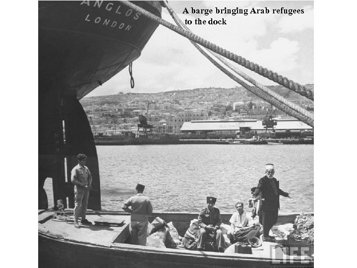 A barge bringing Arab refugees to the dock