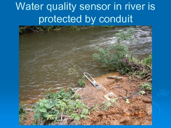 Water quality sensor in river is protected by conduit