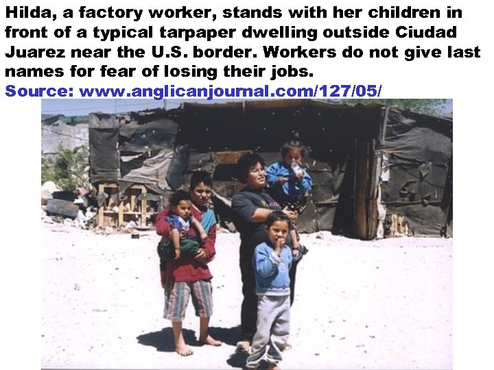 Hilda, a factory worker, stands with her children in front of a typical tarpaper