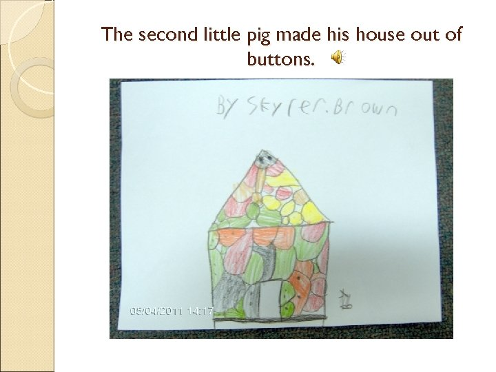 The second little pig made his house out of buttons.