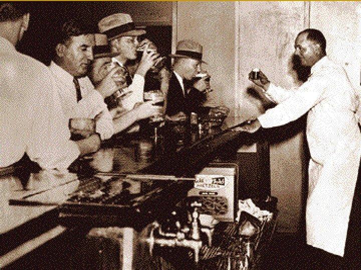 Al Capone Detroit police inspecting equipment found in a hidden underground brewery during Chicago