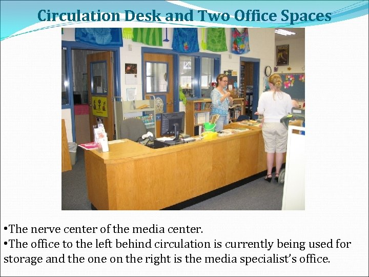 Circulation Desk and Two Office Spaces • The nerve center of the media center.