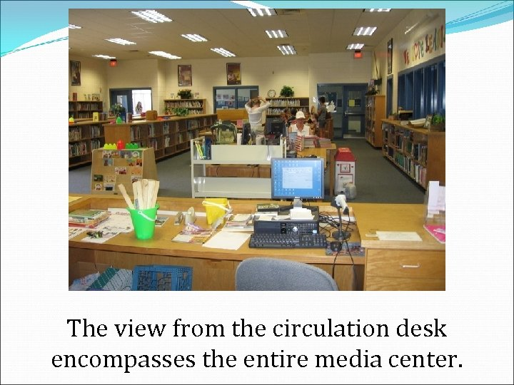 The view from the circulation desk encompasses the entire media center.