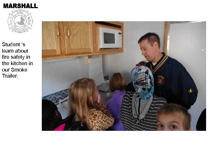 Student 's learn about fire safety in the kitchen in our Smoke Trailer.