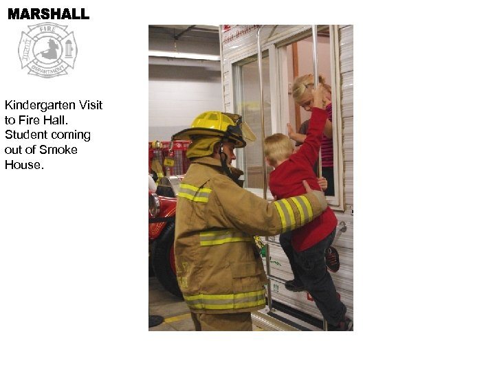 Kindergarten Visit to Fire Hall. Student coming out of Smoke House.