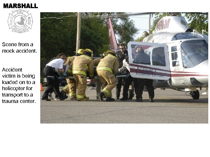 Scene from a mock accident. Accident victim is being loaded on to a helicopter