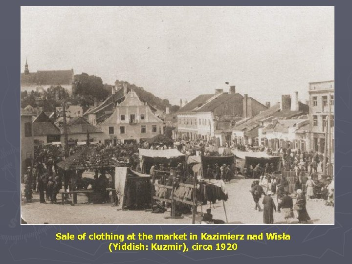 Sale of clothing at the market in Kazimierz nad Wisła (Yiddish: Kuzmir), circa 1920