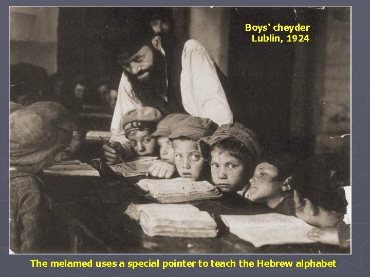 Boys' cheyder Lublin, 1924 The melamed uses a special pointer to teach the Hebrew
