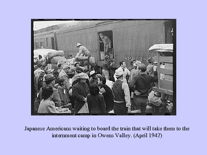 Japanese Americans waiting to board the train that will take them to the internment