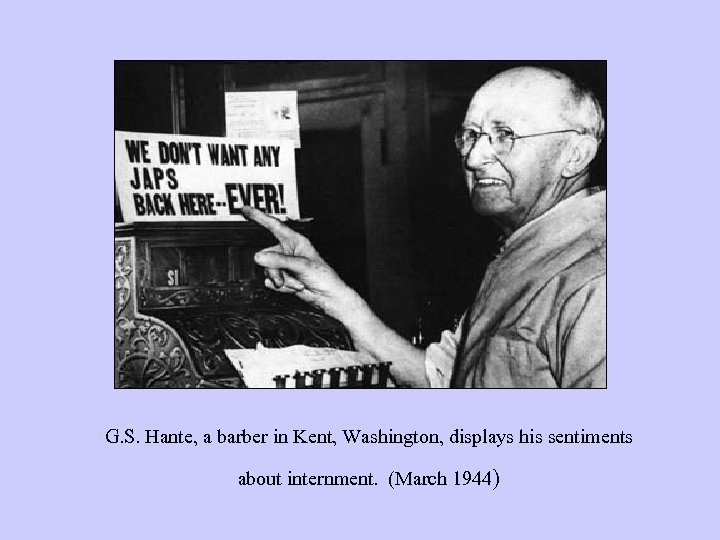 G. S. Hante, a barber in Kent, Washington, displays his sentiments about internment. (March