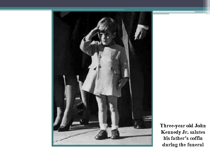 Three-year old John Kennedy Jr. salutes his father's coffin during the funeral