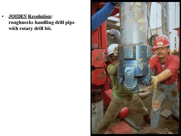 • JOIDES Resolution: roughnecks handling drill pipe with rotary drill bit.
