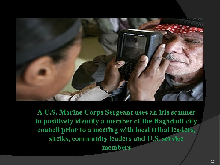 A U. S. Marine Corps Sergeant uses an iris scanner to positively identify a