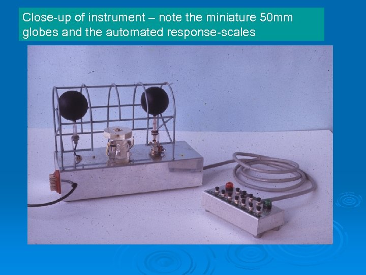 Close-up of instrument – note the miniature 50 mm globes and the automated response-scales