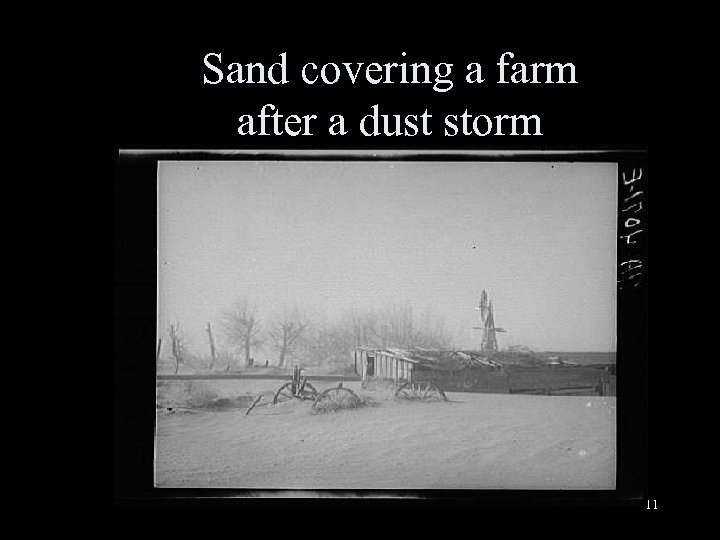 Sand covering a farm after a dust storm 11