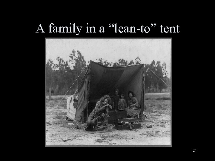 """A family in a """"lean-to"""" tent 24"""