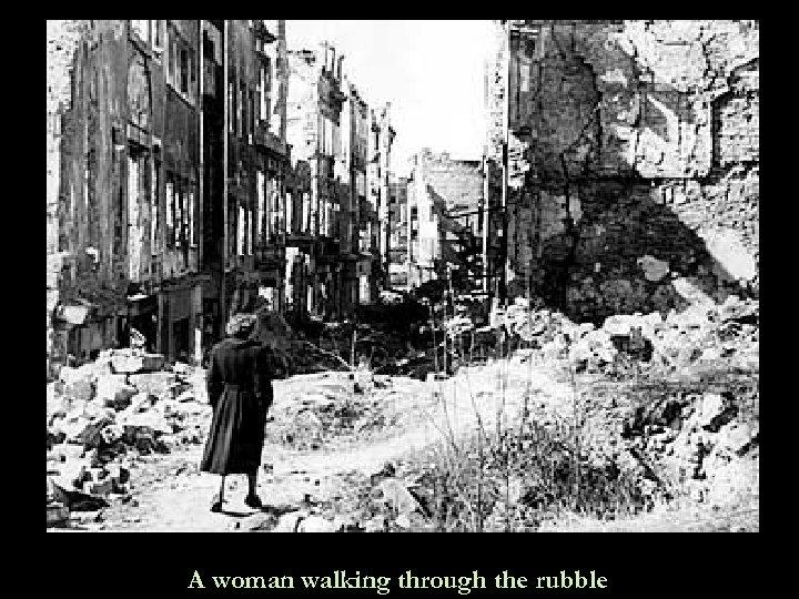 A woman walking through the rubble