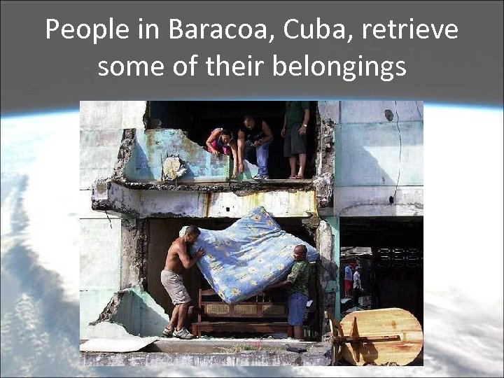 People in Baracoa, Cuba, retrieve some of their belongings