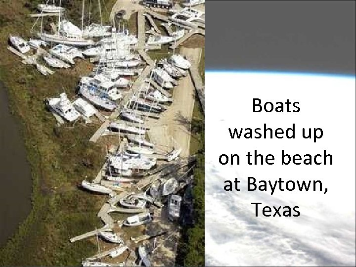 Boats washed up on the beach at Baytown, Texas