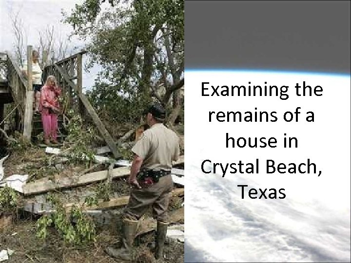 Examining the remains of a house in Crystal Beach, Texas