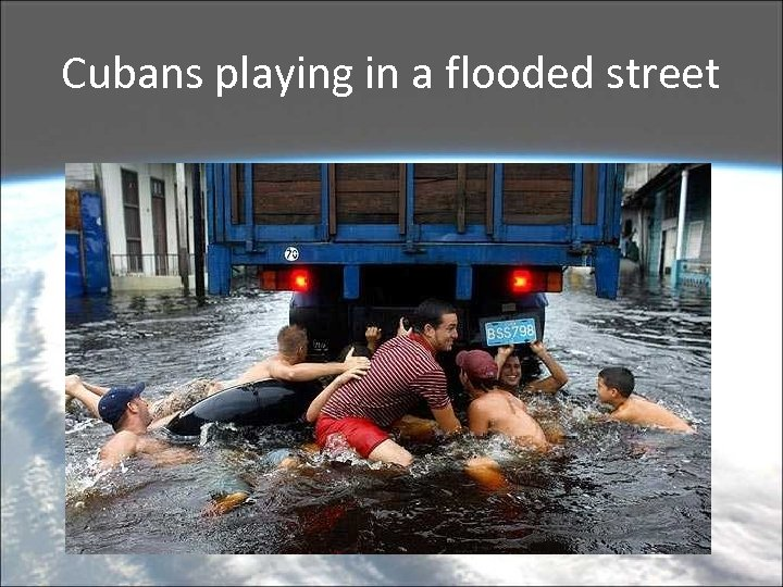 Cubans playing in a flooded street