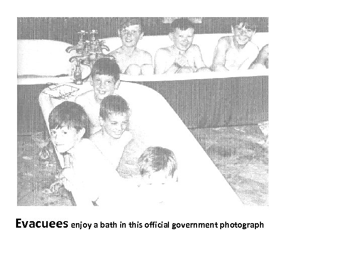 Evacuees enjoy a bath in this official government photograph
