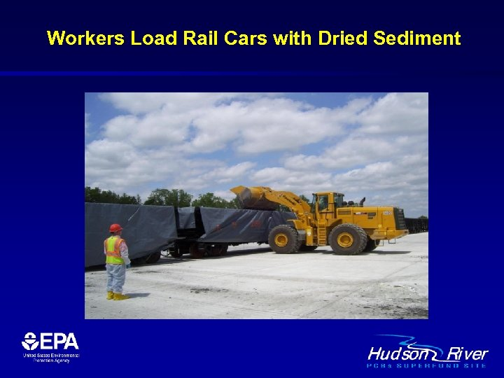 Workers Load Rail Cars with Dried Sediment