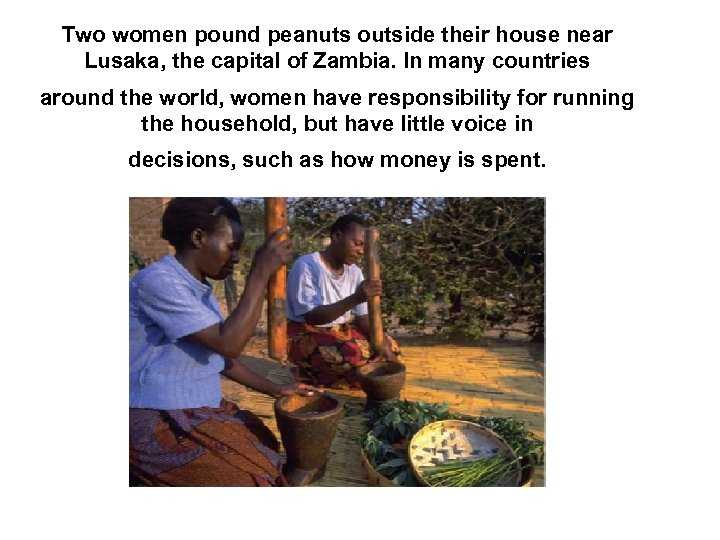 Two women pound peanuts outside their house near Lusaka, the capital of Zambia. In
