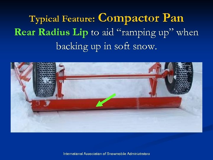 "Typical Feature: Compactor Pan Rear Radius Lip to aid ""ramping up"" when backing up"