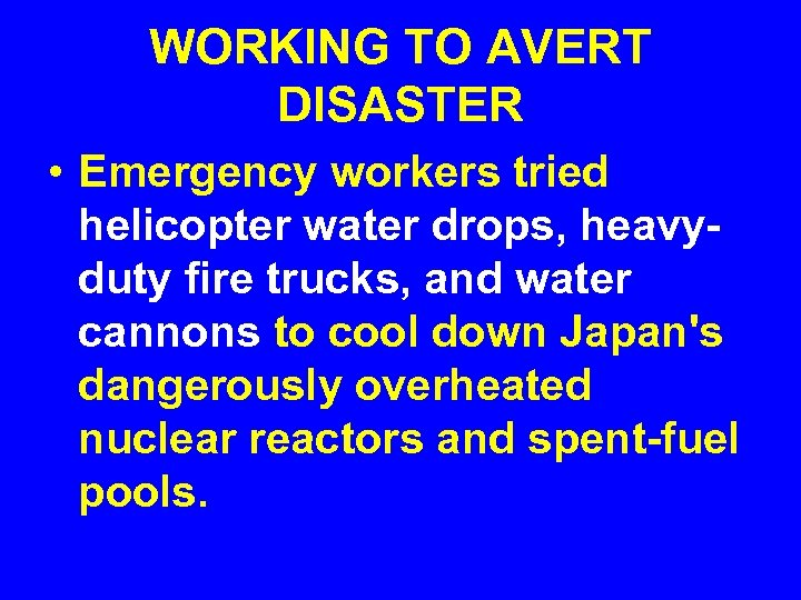 WORKING TO AVERT DISASTER • Emergency workers tried helicopter water drops, heavyduty fire trucks,