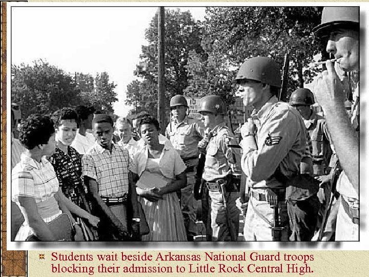 Students wait beside Arkansas National Guard troops blocking their admission to Little Rock Central