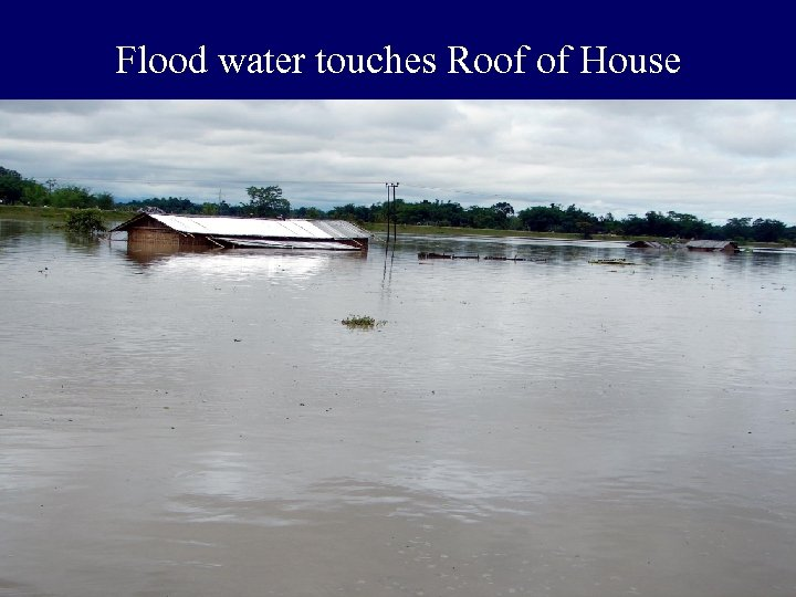 Flood water touches Roof of House