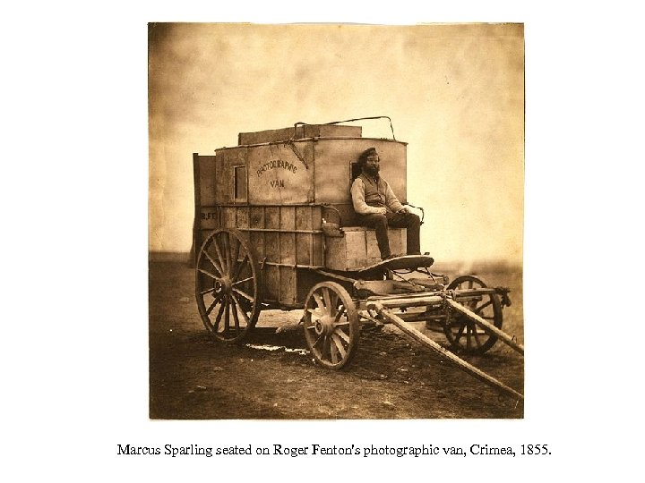 Marcus Sparling seated on Roger Fenton's photographic van, Crimea, 1855.