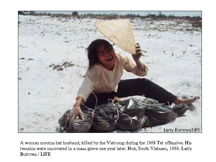 A woman mourns her husband, killed by the Vietcong during the 1968 Tet offensive.