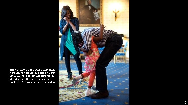 The First Lady Michelle Obama watches as her husband hugs Caprina Harris on March