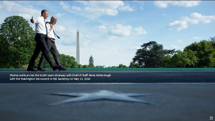 Obama walks across the South Lawn driveway with Chief of Staff Denis Mc. Donough